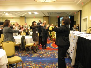 Surgeon General leads conference atendees in an exercise break