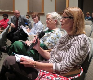 Retired teacher Cheryl Fruits asks a question of NC Treasurer Janet Cowell at last week's listening session.