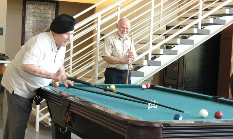 Bobbie Roberts, Sr (l) and his friend Hank Maiden (r) are frequent pool players at the Seymour Center in Chapel Hill