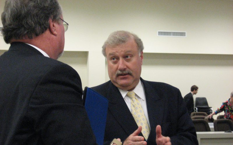 DHHS Secretary Al Delia (r) talks to Sen. Tommy Tucker after Tuesday's Oversight Committee Meeting (R-Waxhaw)