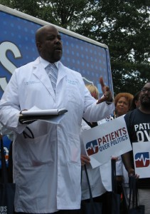 Cedric Bright speaks before the Doctors for America bus
