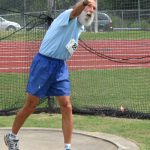 Life-long Outer Banks resident Gary Gaskiln throws the discus at the NC Sr Games, Friday.