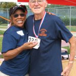 Hillsborough resident Ray Shackelford, 77, shows off his medal in the 1500m race with Sr Games boardmember Louise Gooche.