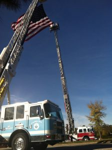 3. Chapel Hill and Carrboro Fire Truck demonstration hoisting an American flag outside of the Friday Center at the 21st Jaycee Burn Reunion.  The burn center gets donations from fire departments around the state.