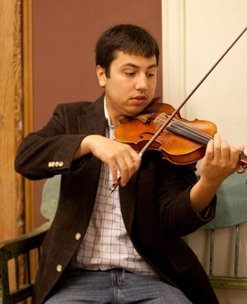 David Binanay playing the violin. He is founder of Music Over Mind and a professional musician. Photo by Alicia Stemper