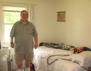 Alex shows off his room. He sleeps with a continuous positive airway pressure machine to help his breathing. He recently was able to stop taking diabetes medication after losing some weight.