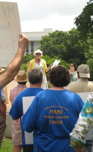 NAMI-NC head Deby Dihoff instructs the crowd gathered in front of the General Assembly Tuesday on how to advocate for their needs to legislators. Photo credit: Rose Hoban