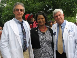 Family physicians Arthur Axelbank (l) and Samuel Warburton (r) pose with Rep. Carla Cunningham (D-Charlotte), who is a registered nurse.