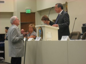 Committee Chair Mark Hollo (R-Taylorsville) talks to one of the House Sergeant-at-arms
