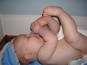 Baby sucking toes