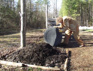 Rolling the compost barrel to mix it up at XDS's Penny Lane farm.
