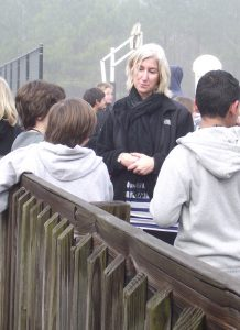 Fifth grade teacher Kristy Perone talks over the day's lesson with several students after their walk around Scroggs Elementary School in Chapel Hill.