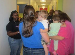 TAC member leading a tour for teens and a dults at the Grand Opening of the Teen Wellness Center, April 2012
