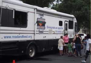 The Read and Feed van distributes books to kids who also come for a meal