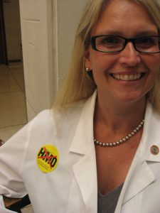 "Internal medicine doctor Tracey Eskra from Goldsboro was one of many physicians sporting a ""No HMO"" sticker."