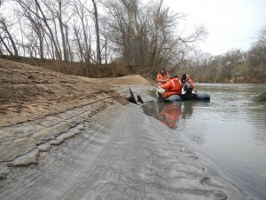 Staff from the U.S. Fish and WIldlife Service take core samples following the spill of coal ash into the Dan River. Photo courtesy U.S. Fish and Wildlife Service