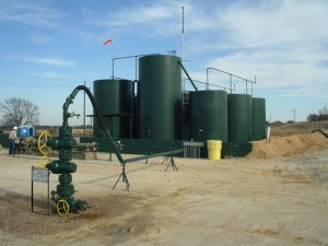 Storage tanks used to hold drilling fluids. Tanks leak volatile organic compounds, which is a concern for nearby residents. Photo courtesy: U.S. Bureau of Indian Affairs