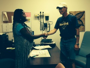 Charita McCollers, Clinic Social Worker, meeting with a patient and discussing his ongoing case management needs.