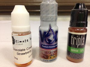 Some of the e-cigarette liquids for sale in N.C. today. Flavors from left to right: watermelon, Irish Cream and appletini.