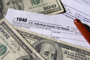image of money and tax forms