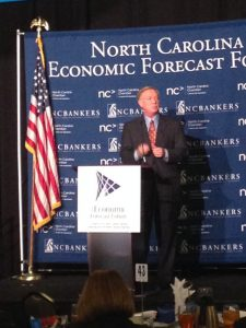 BCBSNC head Brad Wilson told close to a thousand bankers and business leaders that North Carolina should expand the Medicaid program at the N.C. Bankers Association economic outlook forum Monday in Research Triangle Park. Photo credit: Rose Hoban