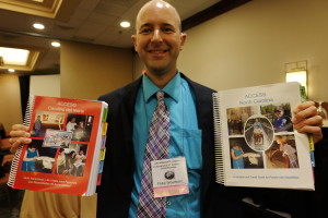 Philip Woodward displays copies of ACCESS NC in both English and Spanish.