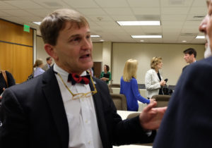 After the Senate Health Care Committee meeting Tuesday, State Health Director Randall Williams makes a point to lobbyist John Del Giorno, who represents the pharmaceutical industry.