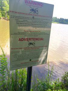Signs warn fishers at Lake Crabtree...