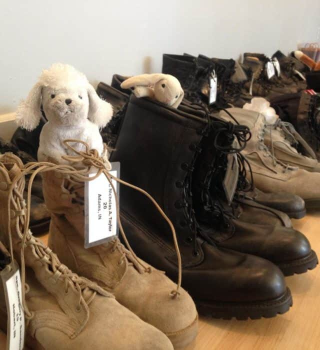 Sixty-one pairs of boots lined the walls at the Kurt Vonnegut Memorial Library, to commemorate Indiana soldiers who died before their 22nd birthday.
