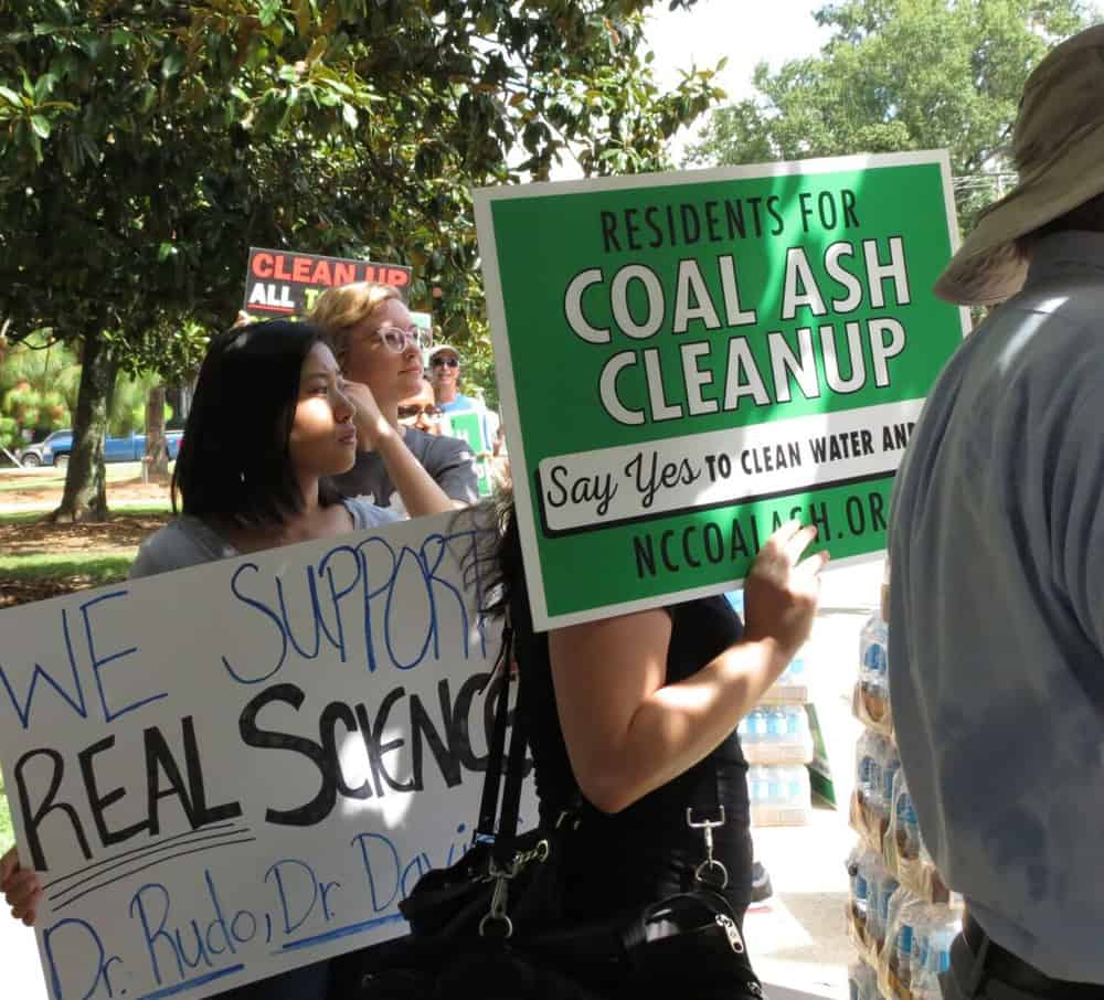 At protests in Raleigh on Thursday, critics of the state's response to possible coal ash risks to well water praised Megan Davies and Ken Rudo. Photo credit: Catherine Clabby