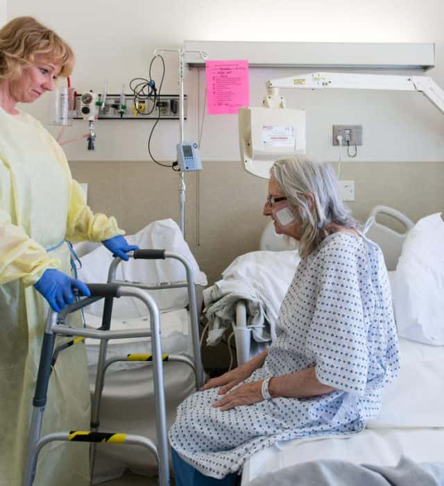 Nurse specialist Annelie Nilsson checks on patient Janet Prochazka, 74, during her stay at the San Francisco General Hospital on Thursday, March 24, 2016.