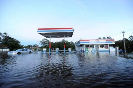 A fuel station in Lumberton inundated by rainwater deposited by Matthew. Many substances get into flood waters: soil, human and animal waste, chemicals and fuel create a toxic mix in floodwaters. Now that dozens of water treatment plants have been exposed to contaminants, it could take weeks for water in some Down East communities to be drinkable. Jocelyn Augustino/FEMA