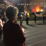 Those who attended Thursday's Candlelight Reflections event at the state fairgrounds listen to speakers who offer personal stories about their experiences with neurocognitive disease.