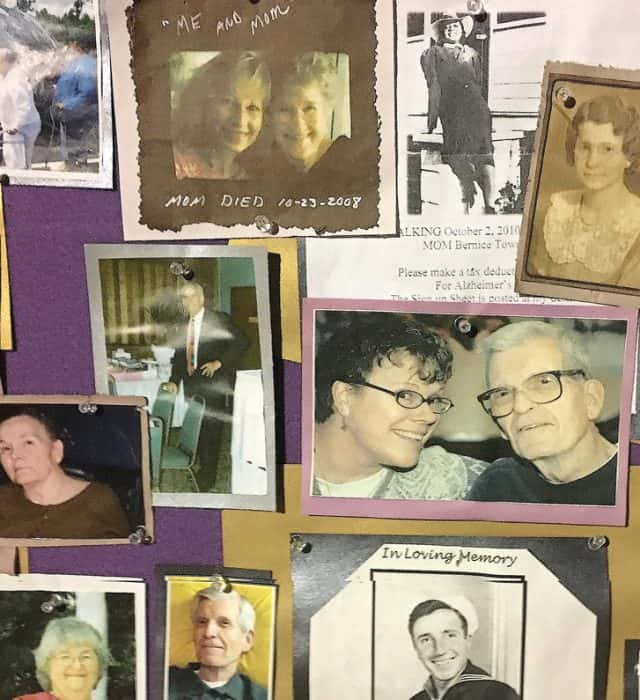 A bulletin board at Thursday's Candlelight Reflections gathering is filled with photographs of friends and loved ones who had been affected by Alzheimer's disease.​ Photograph by Thomas Goldsmith.
