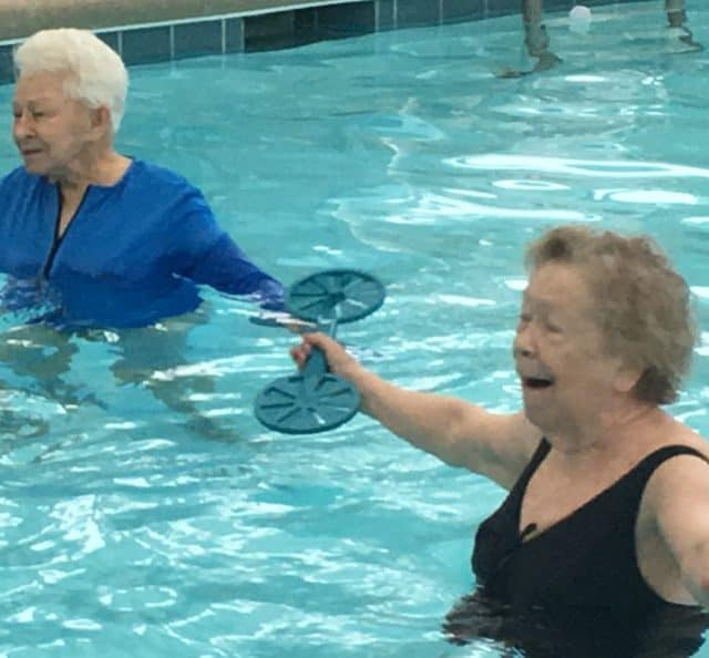 Woodland Terrace residents Pat Frew, left, and Sandy Kirkland take part in aquatics exercise class at the center's swimming pool. Photograph by Thomas Goldsmith
