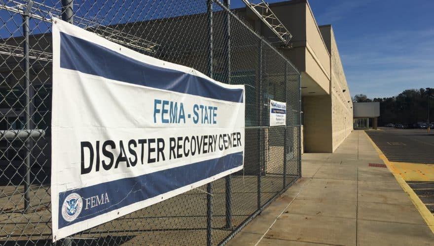 photo of a FEMA sign on a fence