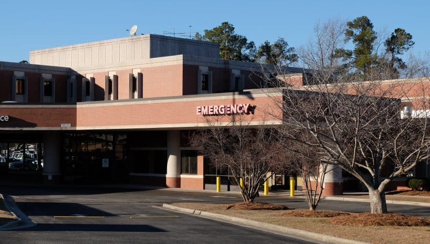 "Generic emergency department entrance photo, with a carport and sign saying ""Emergency"" No hospital name is visible."