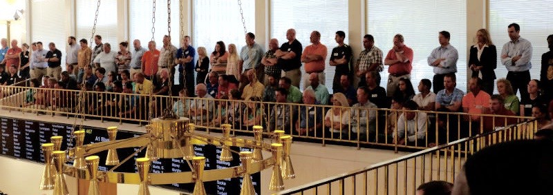 large crowd of people stand in the gallery overlooking the House of Representatives floor.